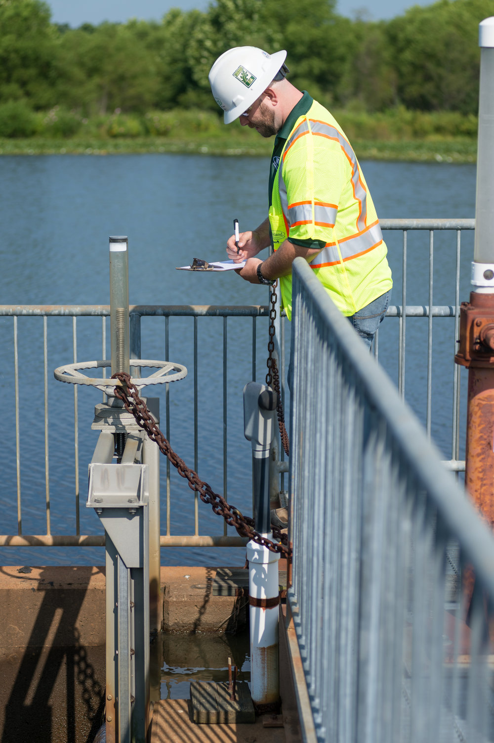 WSSI staff inspecting a dam.