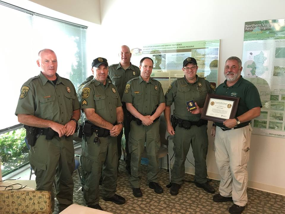 Virginia Conservation Police Officers presented Mike Rolband with the Protector Challenge Coin to recognize his commitment to the Virginia Department of Game & Inland Fisheries' mission and work.