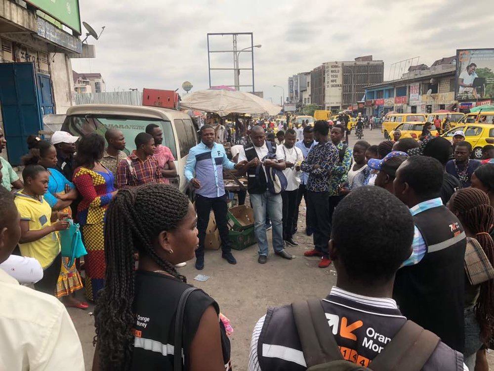 Launch of Orange Money financial inclusion campaign for street vendors at Place Victoire in Kinshasa.