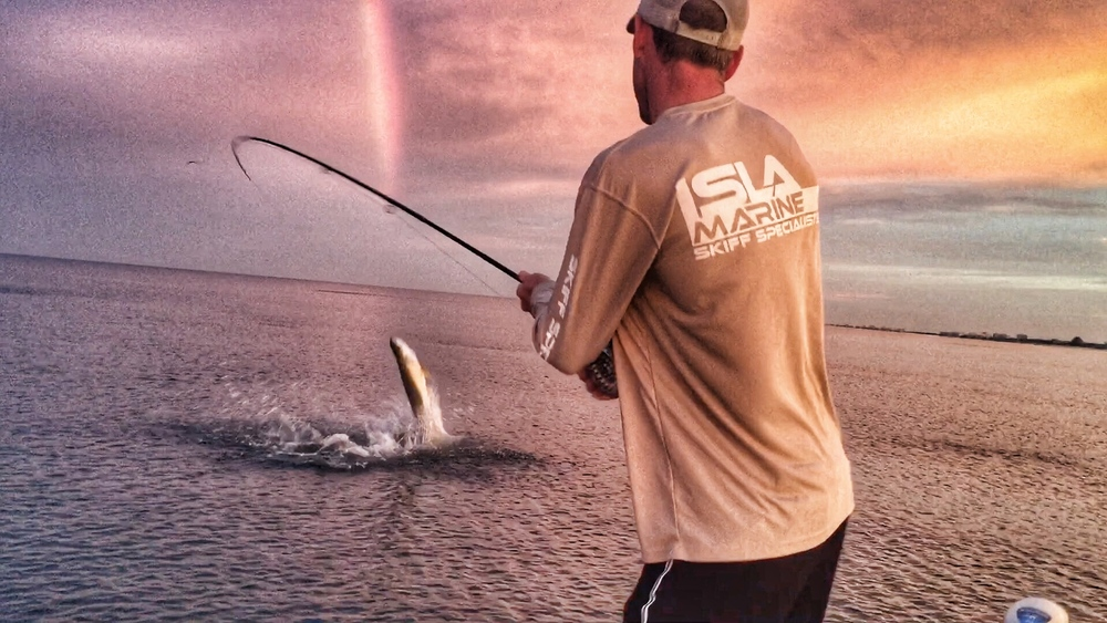 """The sky was insane and the tarpon were going nuts.  As soon as my fly hit the water on my first cast I was hooked up."""