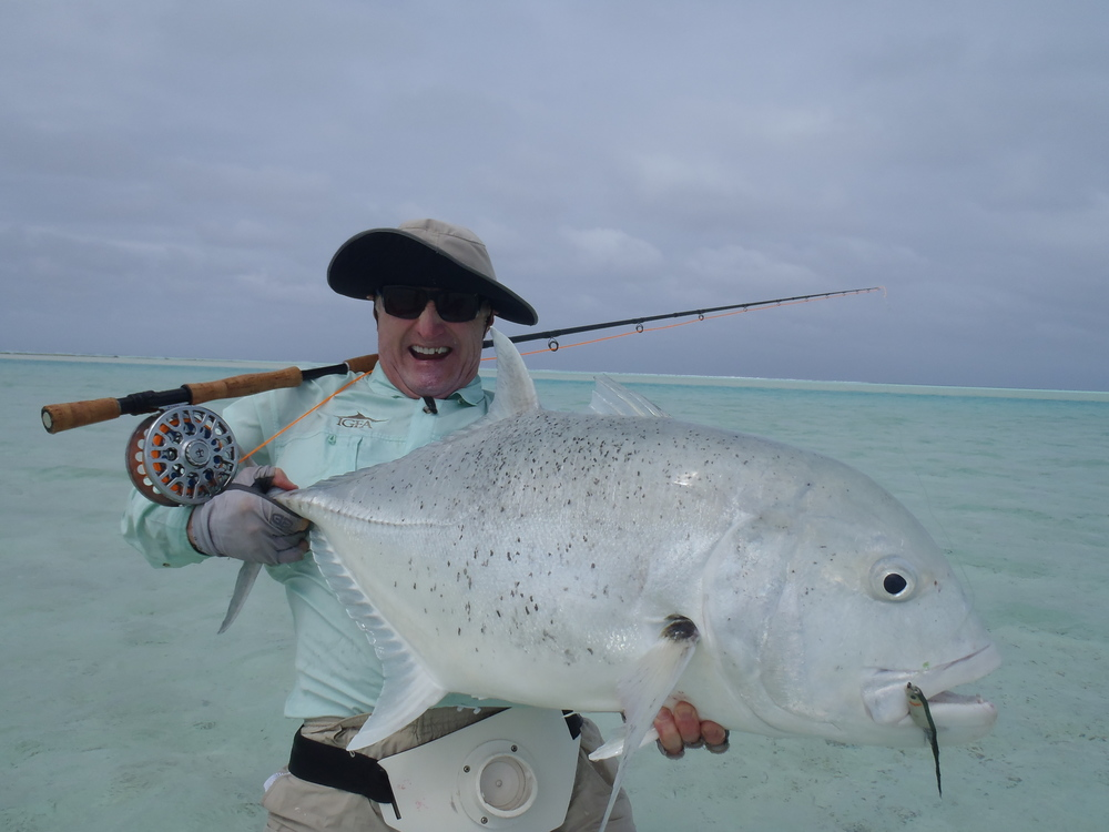 "Jan Forszpaniaks with a 49.5"" long FREAK of a GT in the S. Pacific on our T-150 and a RISE 14-wt rod ( www.RiseFishing.com )."