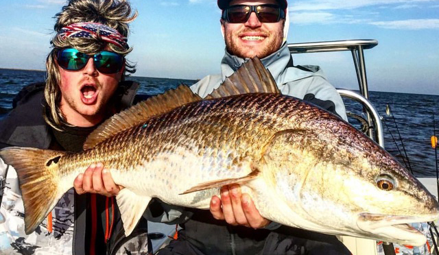 Fly fishing personality Billy Chesapeake and his fishy fellow friend with a jaw-dropping red.