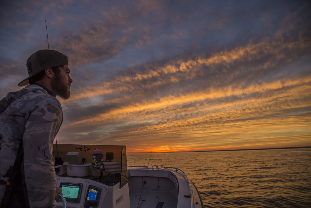 JJ at Helm at Sunset.jpeg