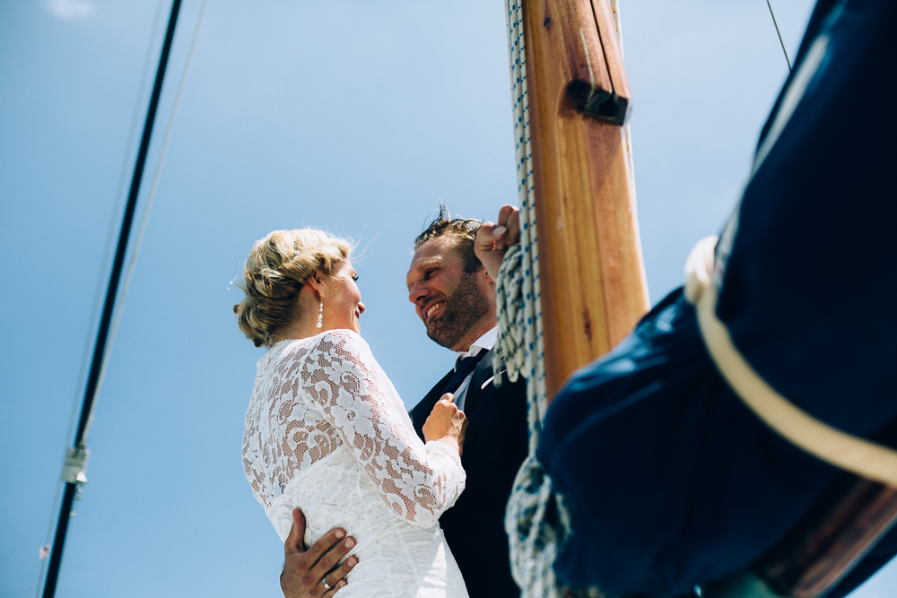 bride-groom-on-boat-smiling.jpg