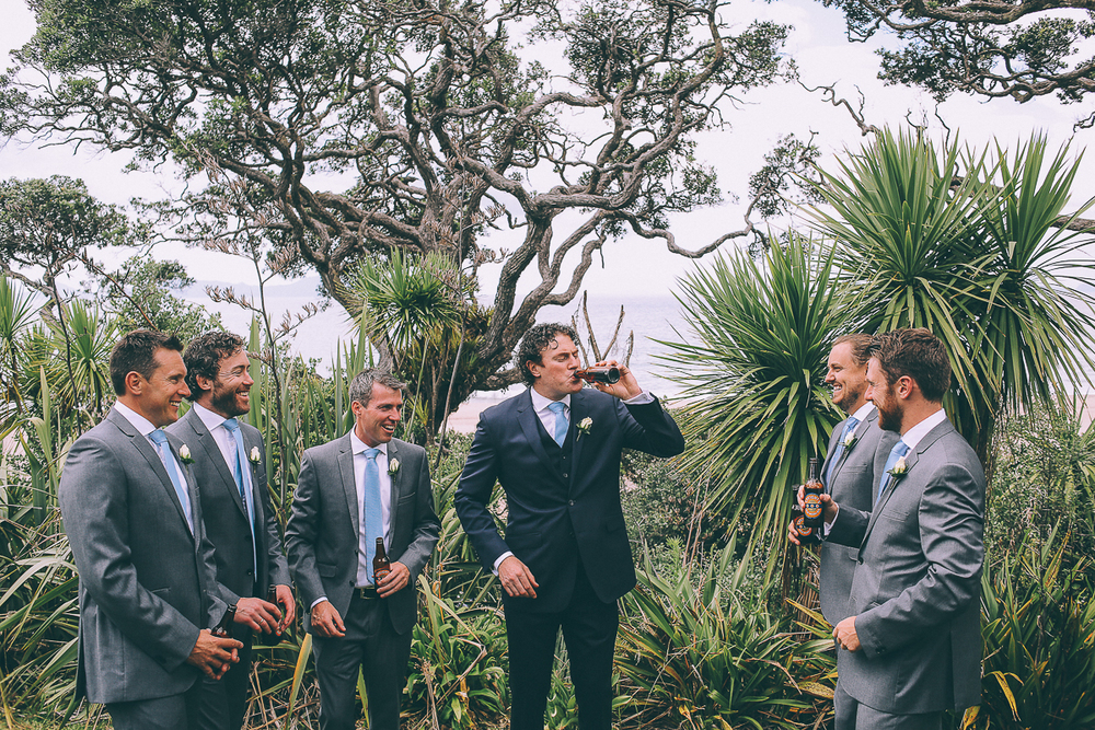 groom-and-groomsmen-drink.jpg