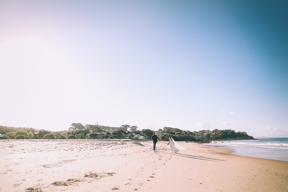 bride-and-groom-beach-walk.jpg