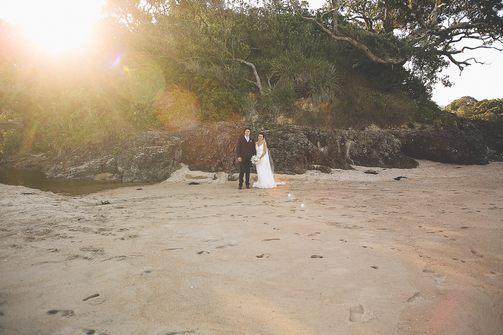 backlight-bride-and-groom-pose.jpg