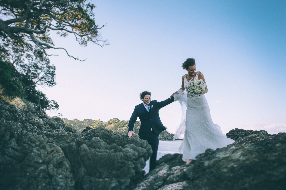 bride-and-groom-walk-rocks.jpg