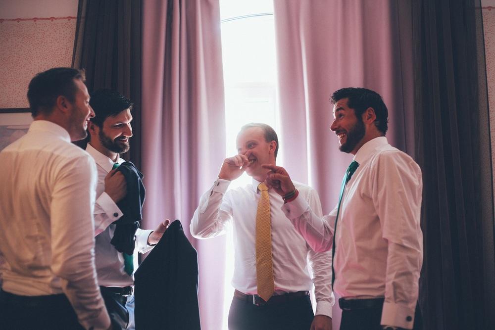 groom-getting-ready-smile.jpg
