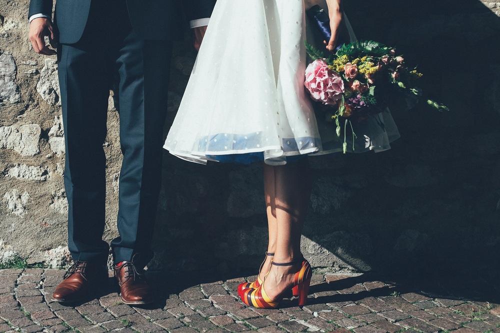 bride-groom-legs-bouquet.jpg
