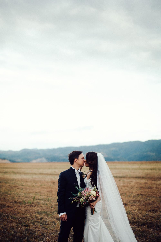 78-groom-bride-kissing.jpg