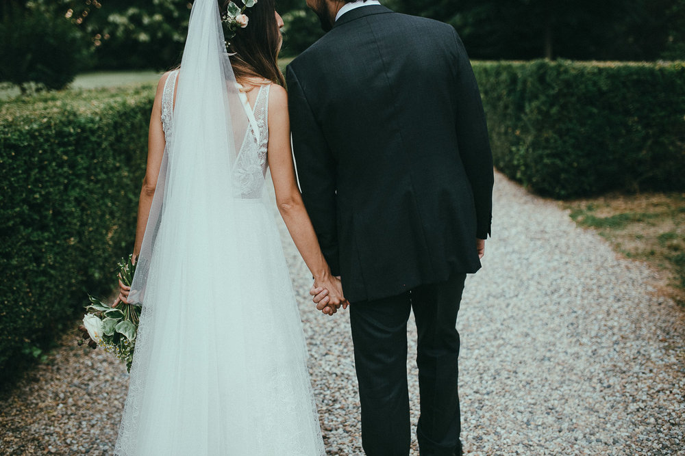 76-bride-and-groom-walking.jpg