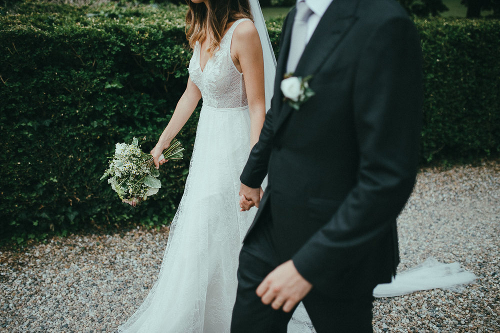 79-bride-and-groom-walking.jpg
