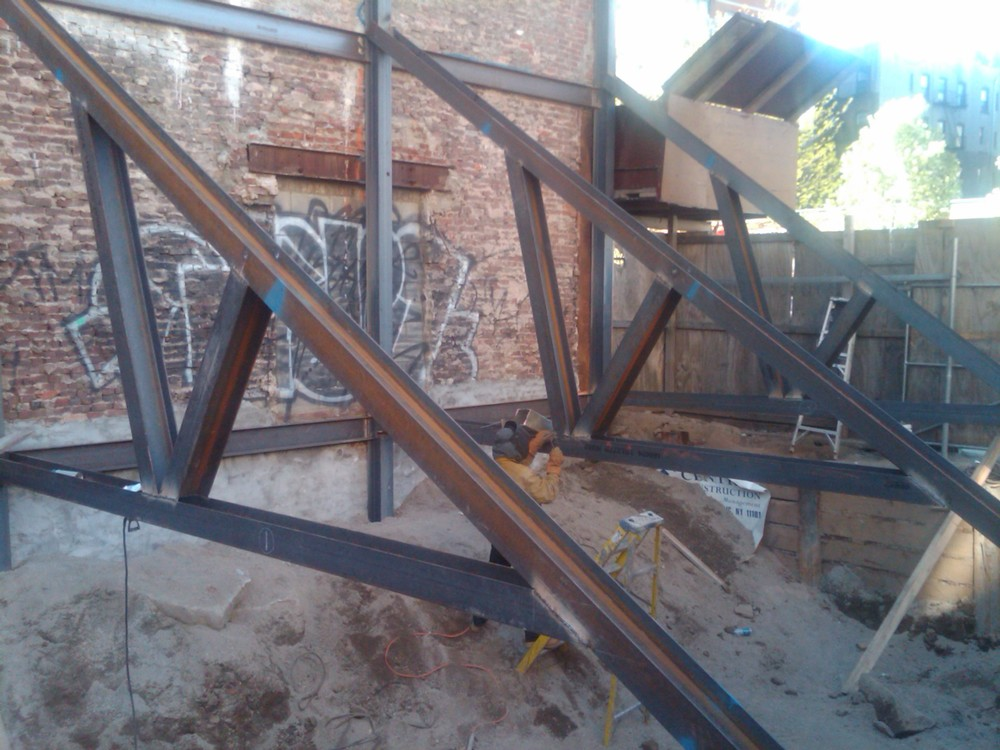 "Structural ""rakes"" temporary emergency supports fabricated and installed onsite"