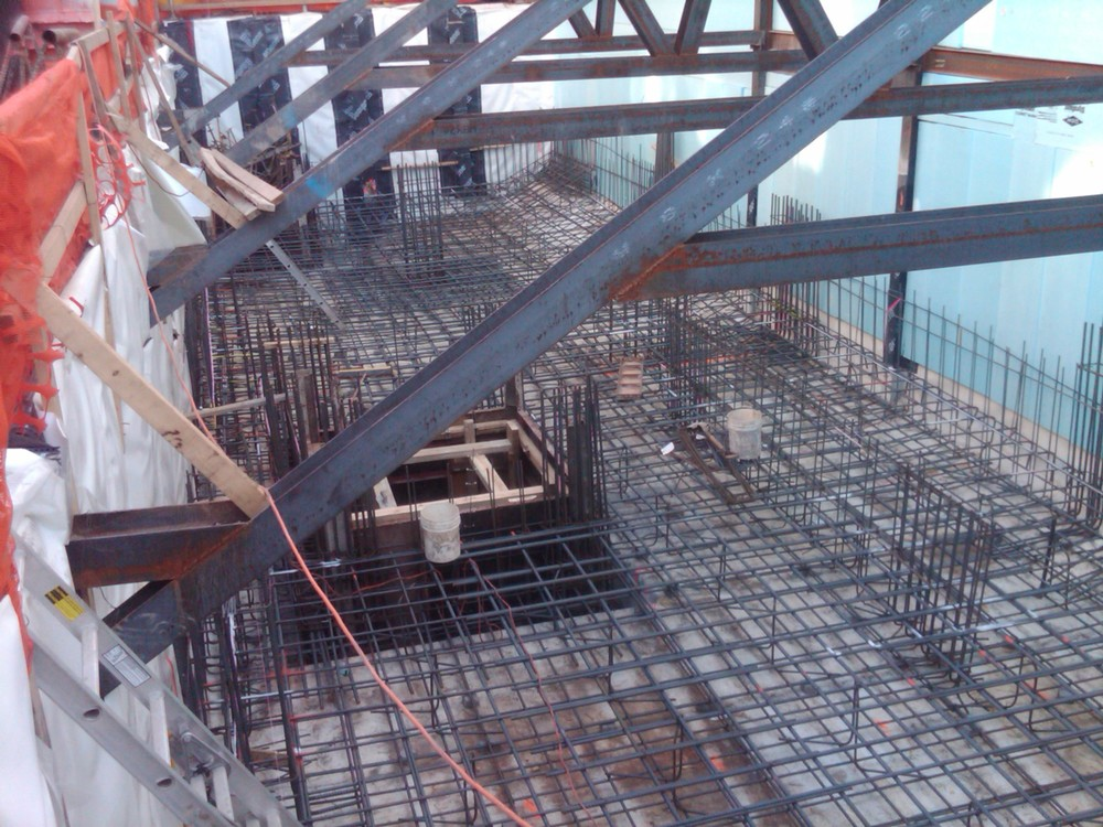 "Structural rebar assembly for a 3ft ""MAT"" slab foundation with 2 elevator pits & pre proof waterproofing"