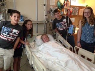 Bailey with his family on his 15th birthday, two days after his SWB accident