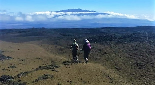 Walking along the barren landscape of Mauna Loa - Unbelievable!