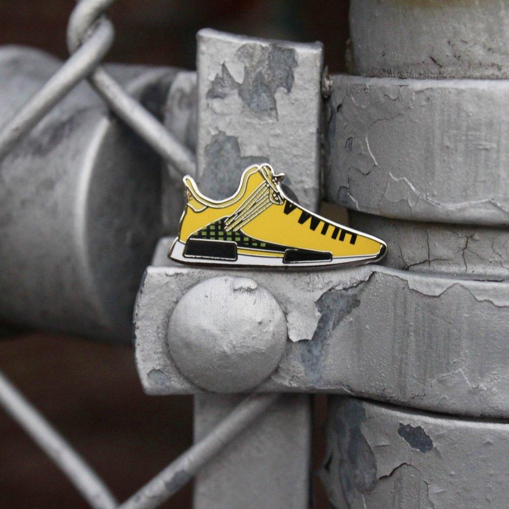 f9ae18fe517a Human NMD sneaker pin