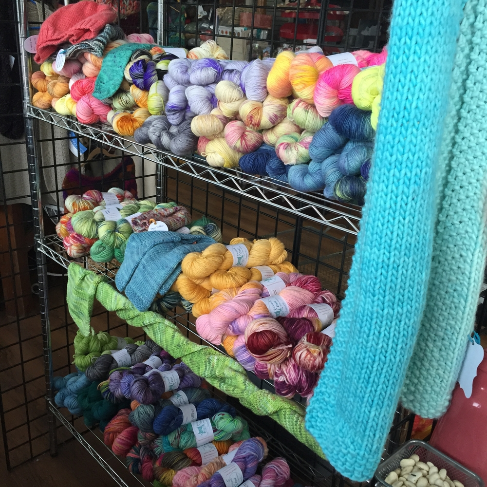 "Some of our yarn and some example pieces. An ombre scarf in Single Ply Worsted (""I Do!"" color way)"