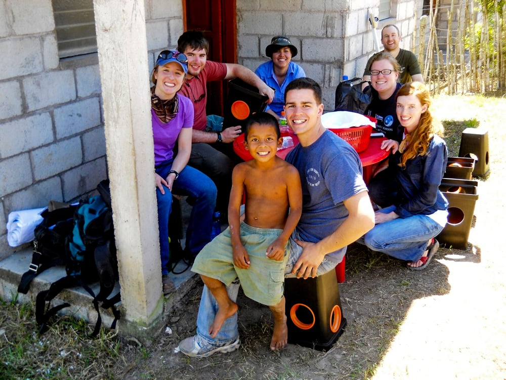 EWB students Whitney Chamberlain, Nick Oberti, Ruth Castillo, Kyle Coolidge (member), Rita Cooper (team leader), Joanna Miller, Peace Corps translator and Dan Gerges with Marvin.