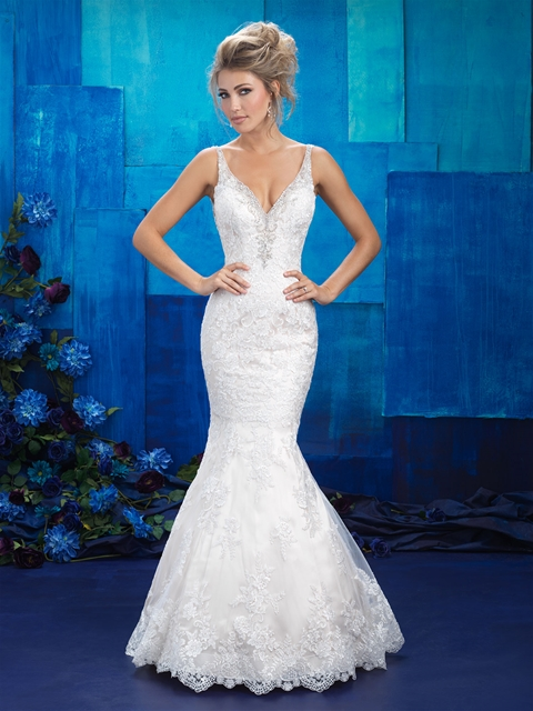 Beaded appliques form fitted straps bridal gown