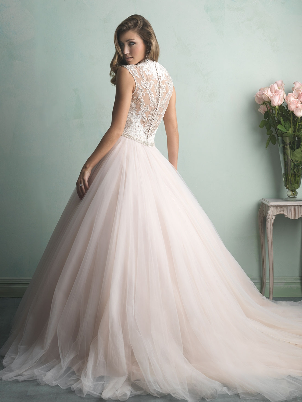 Sheer beaded back bridal gown