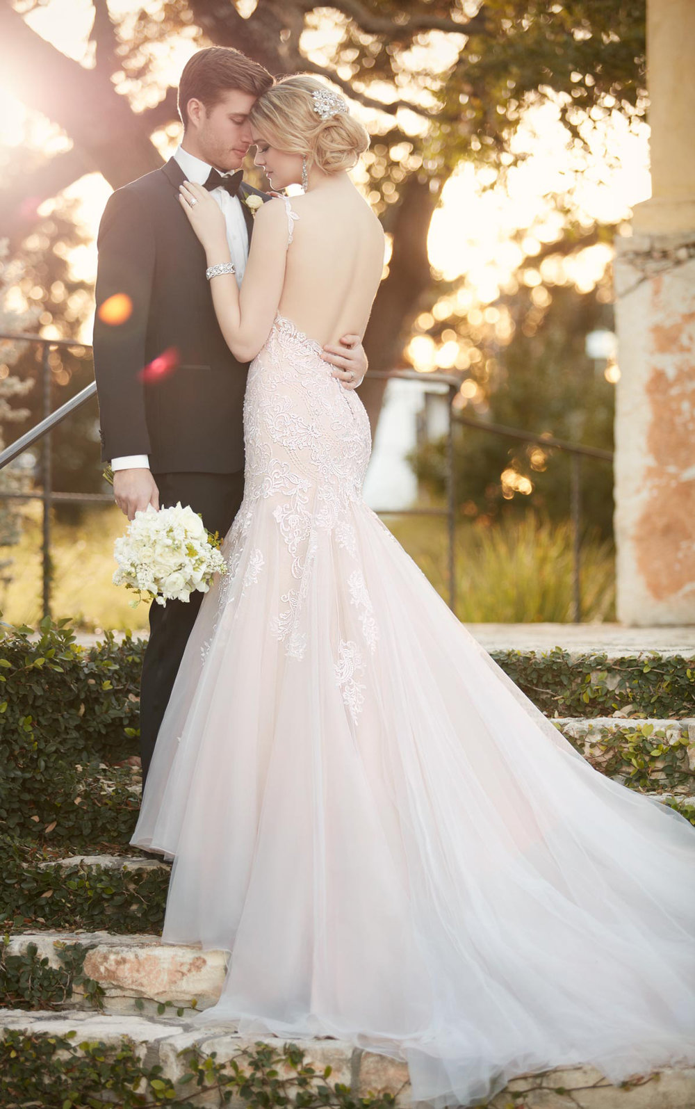 Fit and flare Essense of Australia wedding dress with low-cut back