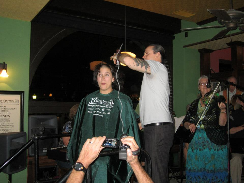 Getting all that hair shaved right off! On stage! With a band!