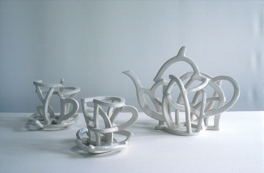 Teapot and cups and saucers