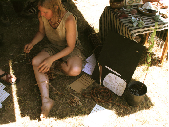Tamara demonstrating leg rolled cordage at the Oregon Country Fair