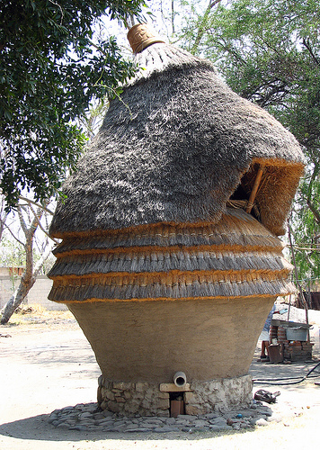 Super neat Mexican granary design utilizing straw and clay in a coiled pot type of form.  This would almost surely use much more clay than I'm using.  I'm intrigued though by the idea of using a mix more similar to the pet to build something larger, like a pigeon cote, a smoker, or maybe a bedroom...