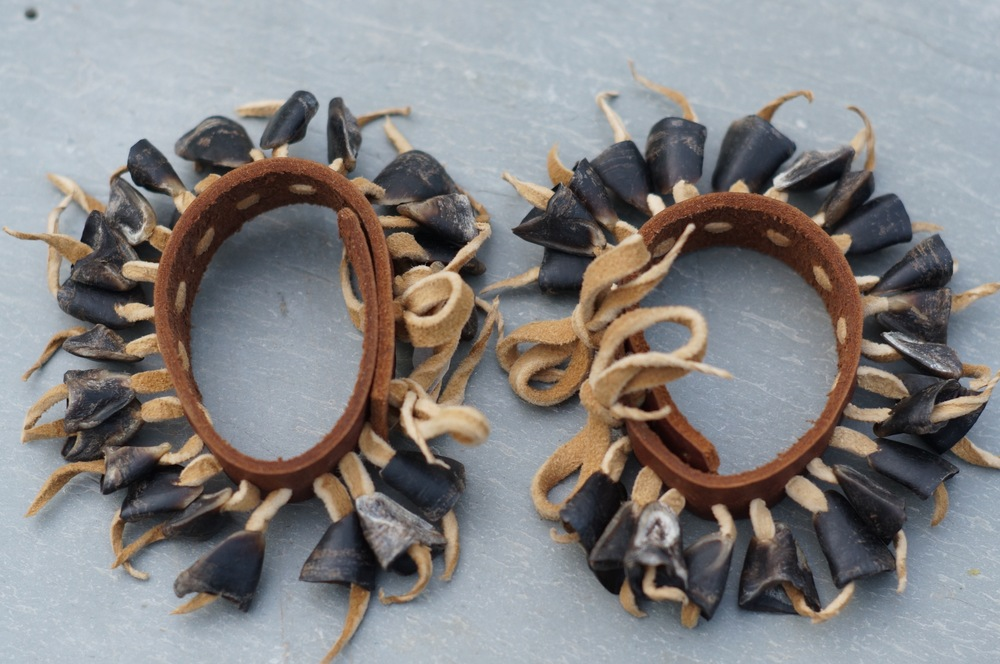 A pair of dewclaw anklets I made.  Braintanned buckskin, bark tanned deer skin and deer dewclaws.