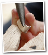 Making handmade silver pendant from childs drawing