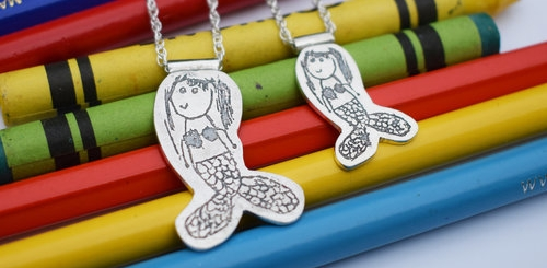Matching Mother and Daughter mermaid necklaces designed by Eve, age 5