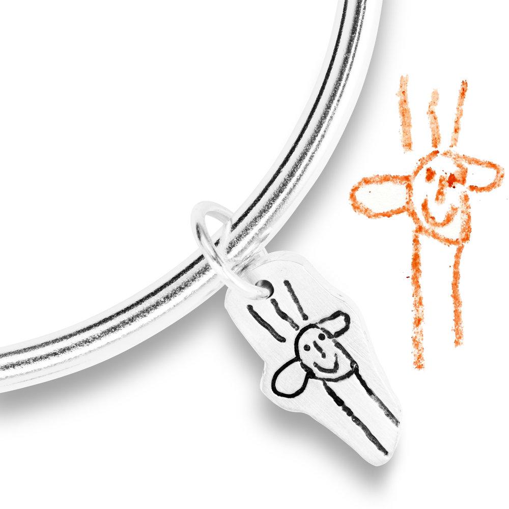 charm on bangle from children's art