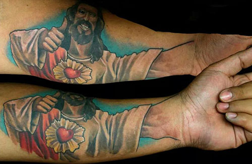 "‏ @ThatKevinSmith     21 Nov 2014   Via  @JorgieSanchez  ""this is my Buddy Christ tattoo "" Wow! Incorporating your own thumb was GENIUS, sir! Jesus sleeves!"