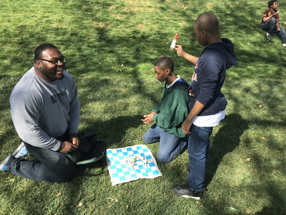 Playing chess with Pobo on the Lawn.