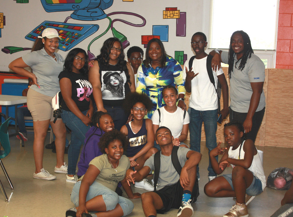 Caprichia with students from the Ready2Win program.