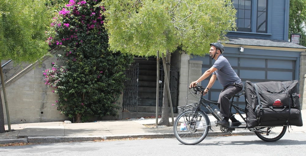 Liam-carries-his-massage-table-on-his-bicycle