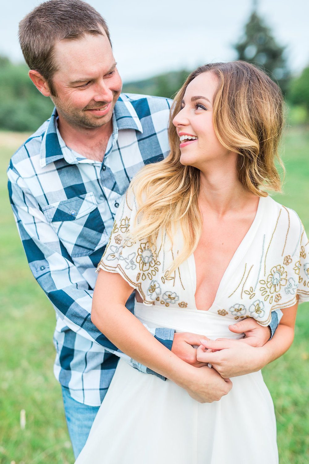 Beautiful outdoor engagement session | What to wear | Photo Inspiration | Engagement session | Portrait | White | Detail Shots | Mastin Labs | Engaged | Fuji 400 | Arms Around Girl