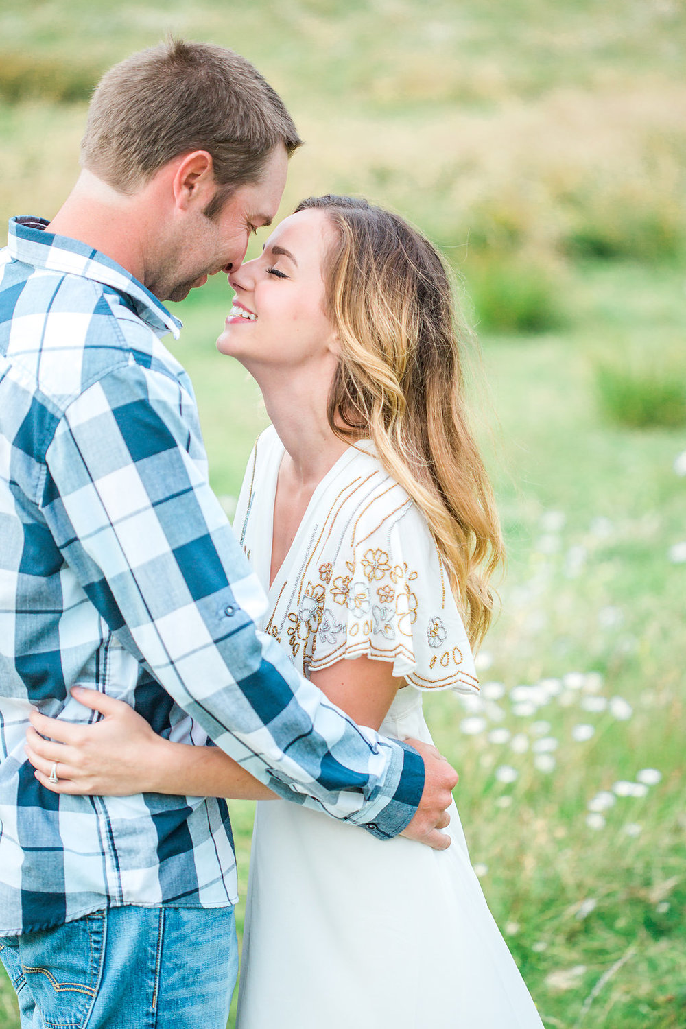 Beautiful outdoor engagement session | What to wear | Photo Inspiration | Engagement session | Portrait | White | Detail Shots | Mastin Labs | Engaged | Fuji 400 | Kiss | Couple in Love