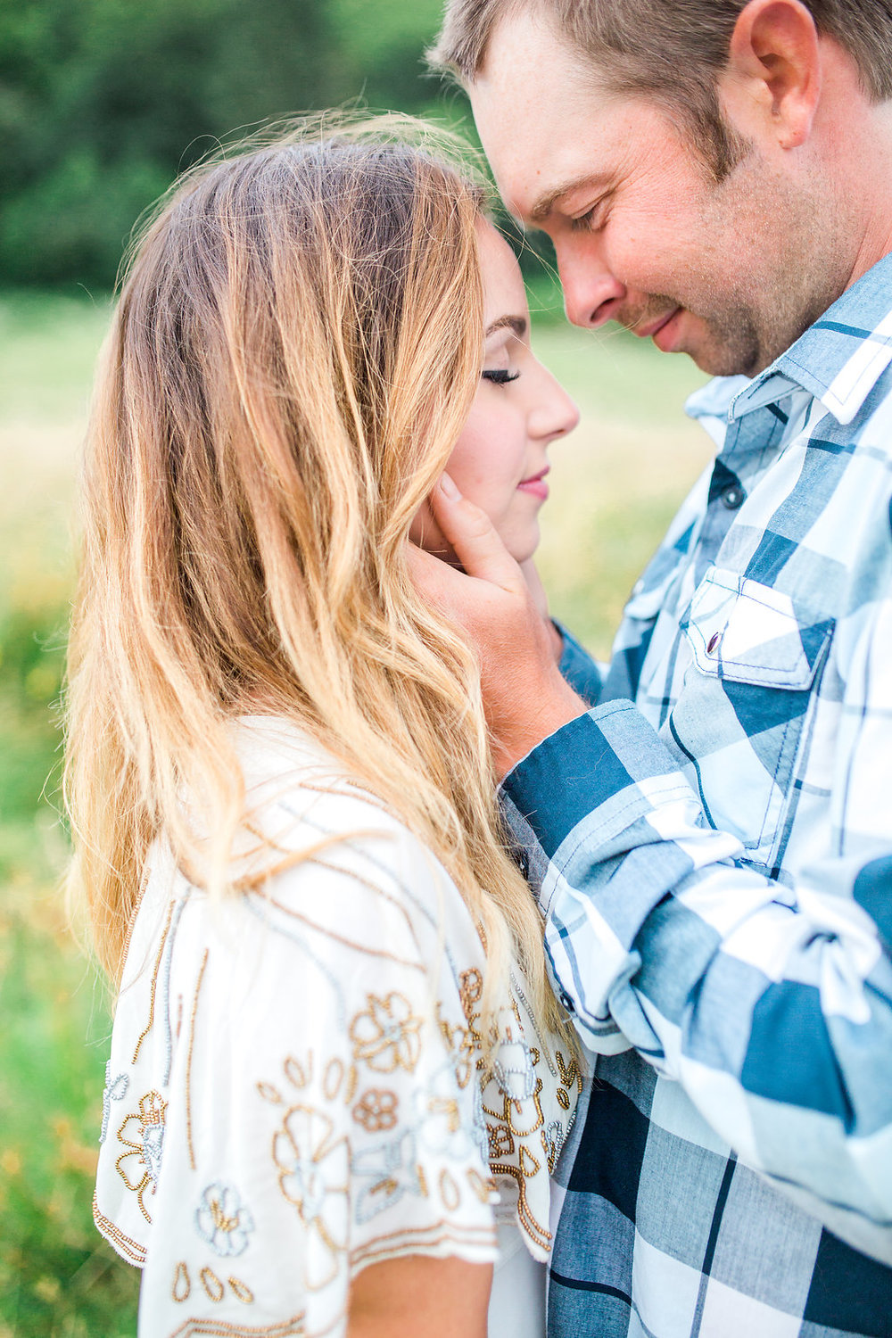 Beautiful outdoor engagement session | What to wear | Photo Inspiration | Engagement session | Portrait | White | Detail Shots | Mastin Labs | Engaged | Fuji 400 | Beautiful Couple | Couple in Love | Beautiful posing and embrace