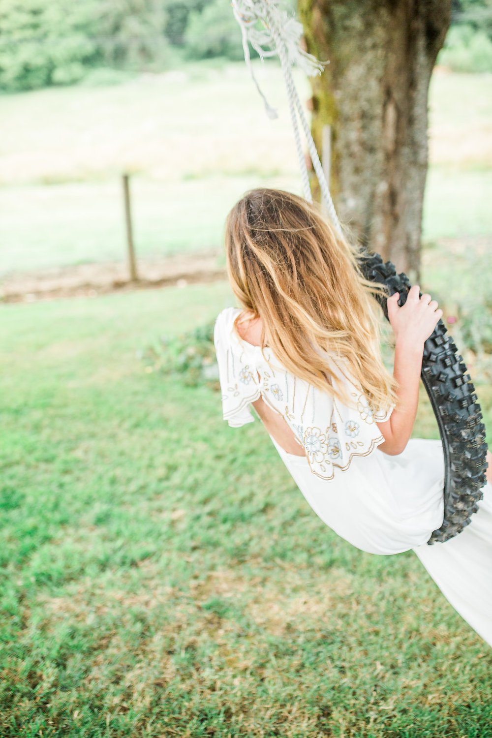 Beautiful outdoor engagement session | What to wear | Photo Inspiration | Engagement session | Portrait | White | Detail Shots | Mastin Labs | Engaged | Fuji 400 | Beautiful Couple | Couple in Love | Beautiful posing | Hair Piece for Photo Session | Engaged to be Married | Tire swing Photo Session