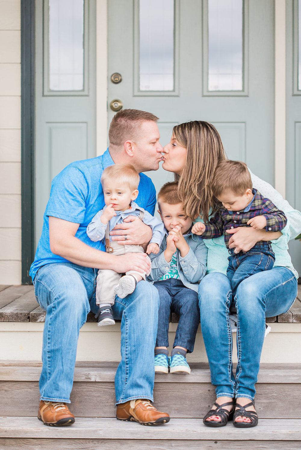 Family Photo Session | What to Wear for Family Pictures | Twin Photo Session | Family Photography | Mastin Labs | Lifestyle Photography | Twin Boys Photo Session | Beautiful Family on Front Porch | Front Porch Photo Shoot | Husband and Wife Kiss Shot | Beautiful Kids