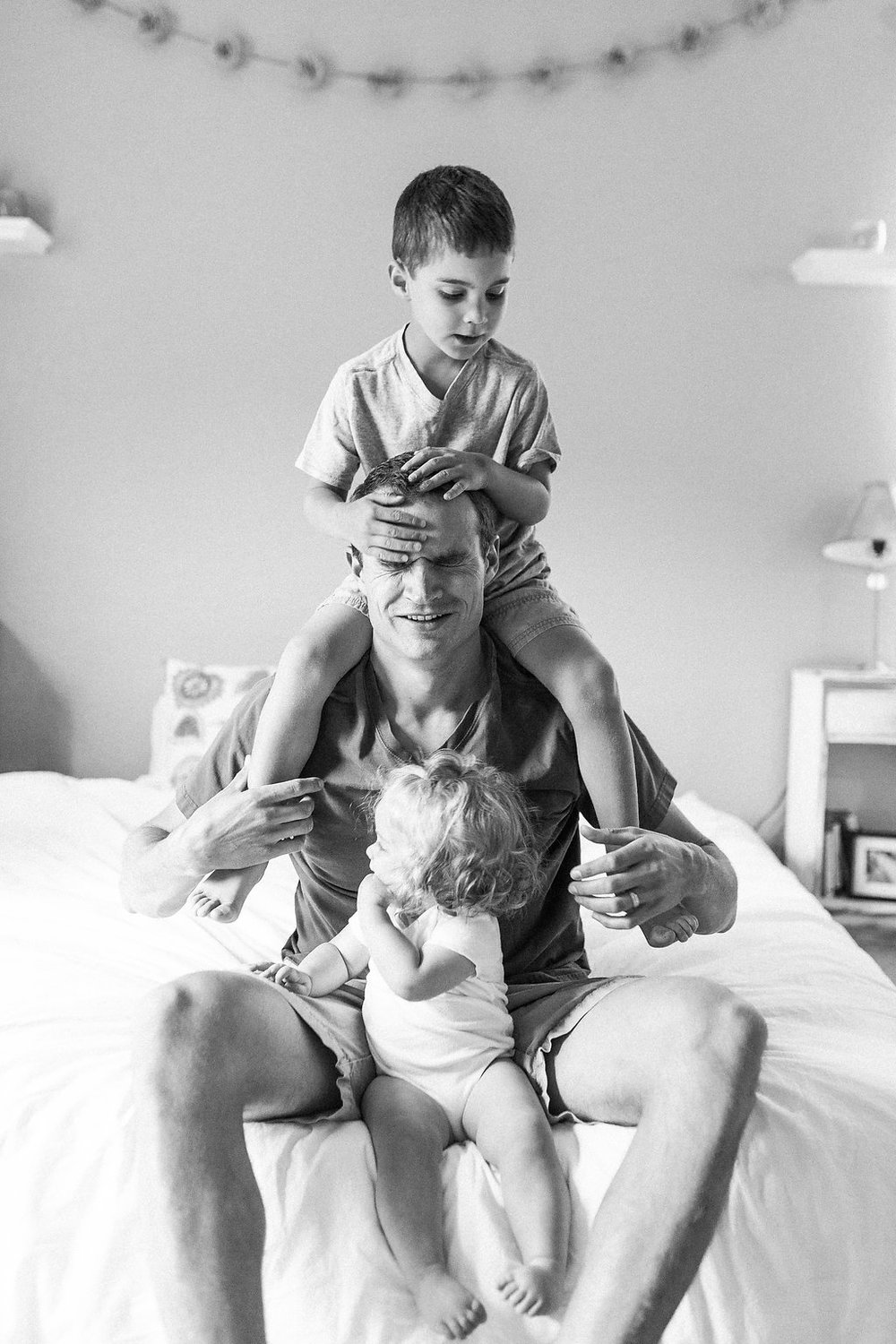 Emma Rose Company   Lifestyle Photographer   Seattle Wedding Photographer   Dad with kids   Black and White Portrait   In Home Lifestyle Session   Family Photo Shoot   Son on Shoulders
