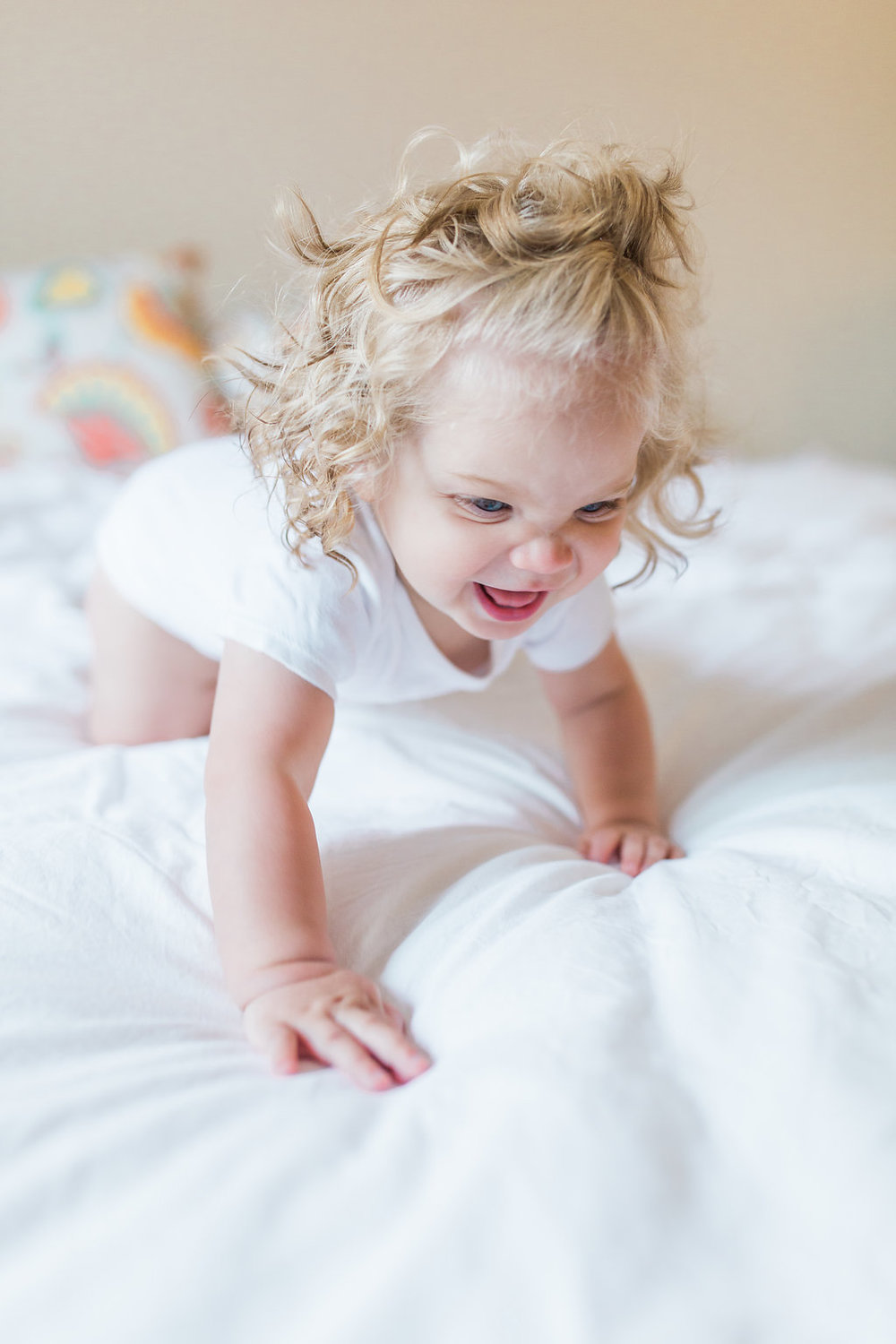 Emma Rose Company   Lifestyle Photographer   Seattle Wedding Photographer   Baby Crawling on bed   In Home Lifestyle Session   Family Photography   Family photo shoot   Adorable Baby Girl   Mastin Labs