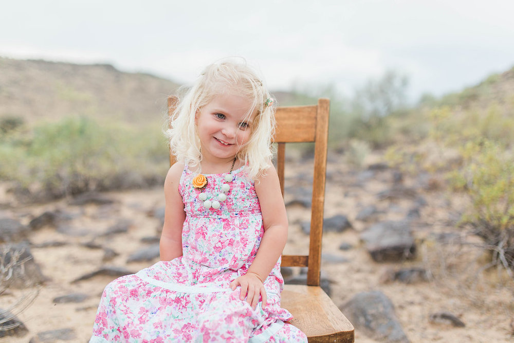 Desert Family Photo Shoot in Arizona | Emma Rose Company | Portrait Photographer | Seattle Wedding Photographer | Adorable Family Photo Shoot Outside | Family Posing | Cute Kids | Family Photo Shoot | Husband and Wife Pictures | What to Wear for pictures | Little Girl Sitting on Wooden Chair