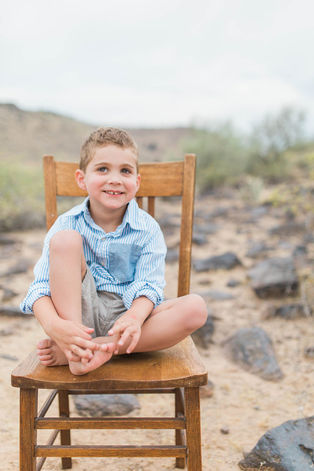 Desert Family Photo Shoot in Arizona | Emma Rose Company | Portrait Photographer | Seattle Wedding Photographer | Adorable Family Photo Shoot Outside | Family Posing | Cute Kids | Family Photo Shoot | Husband and Wife Pictures | What to Wear for pictures | Little Boy Sitting on Wooden Chair