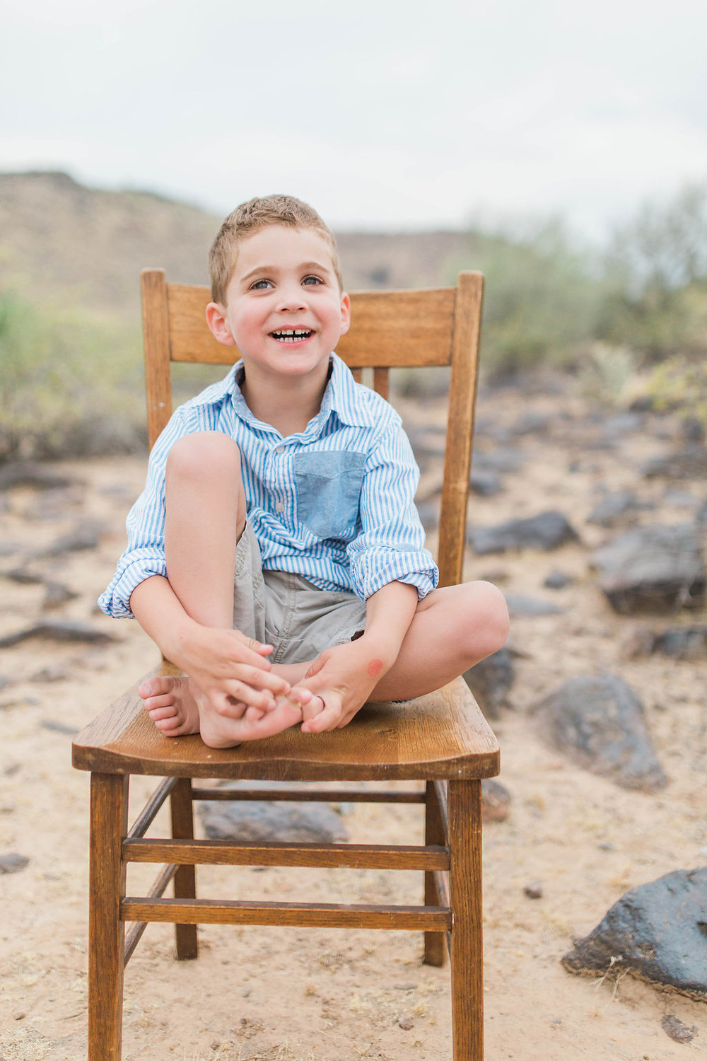 Desert Family Photo Shoot in Arizona   Emma Rose Company   Portrait Photographer   Seattle Wedding Photographer   Adorable Family Photo Shoot Outside   Family Posing   Cute Kids   Family Photo Shoot   Husband and Wife Pictures   What to Wear for pictures   Little Boy Sitting on Wooden Chair