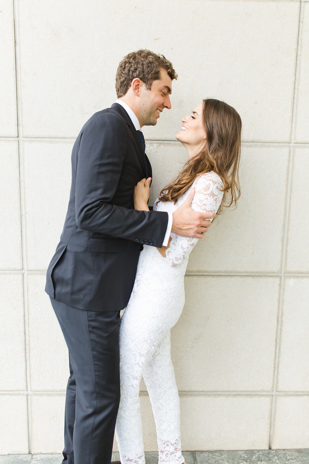 Seattle Courthouse Wedding | Seattle Municipal Court | Downtown Seattle Wedding | Intimate Elopement Wedding | Beautiful Simple Courthouse Wedding | Bride and Groom Portrait | White Wedding Jumpsuit Outfit | Posing Inspiration